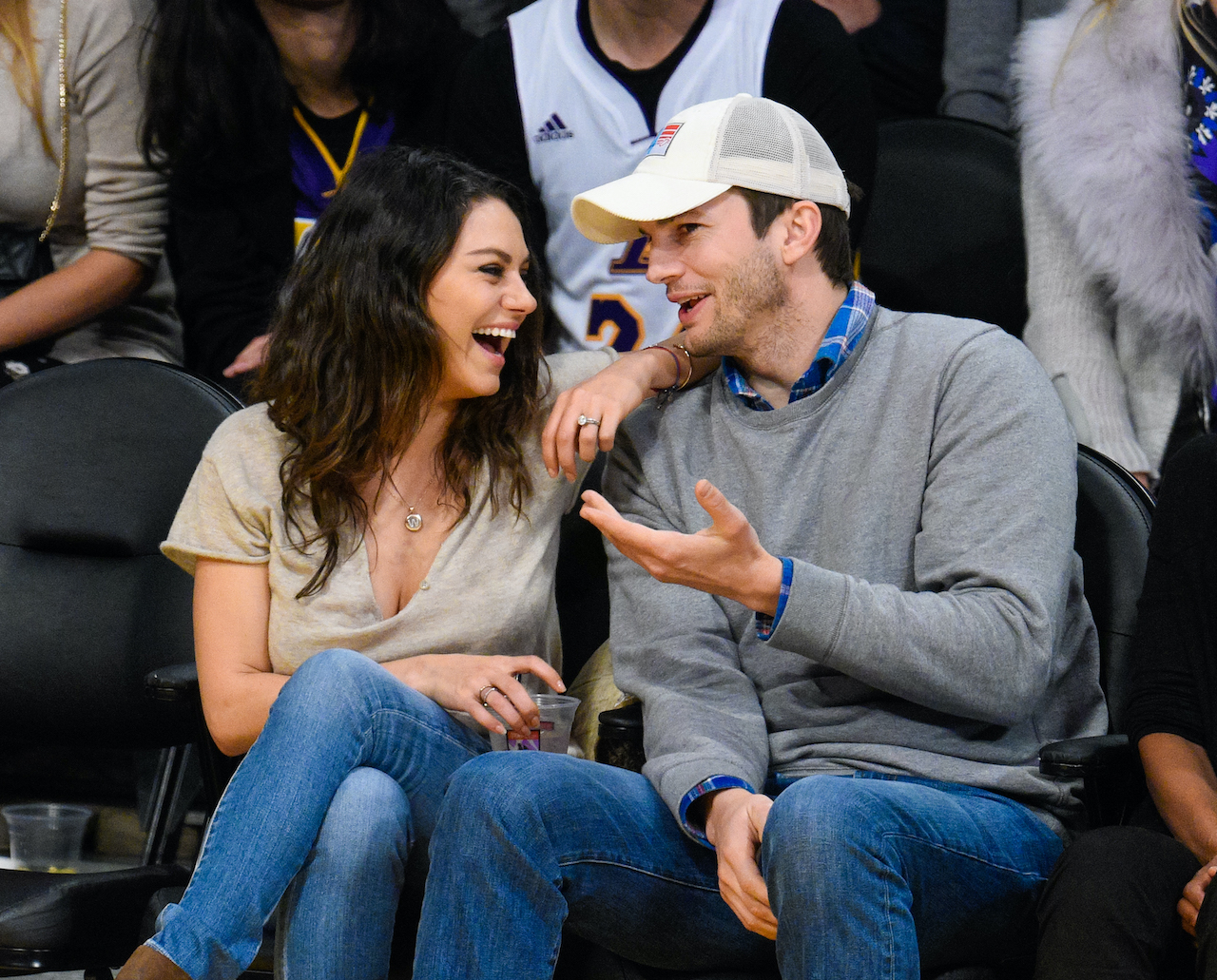 Mila Kunis and Ashton Kutcher attend a basketball game between the Oklahoma City Thunder and the Los Angeles Lakers