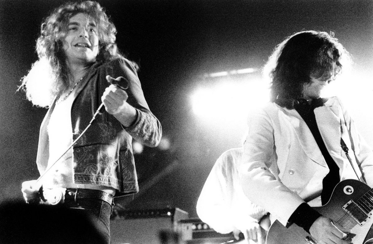 Robert Plant smiles on stage during a Led Zeppelin performance