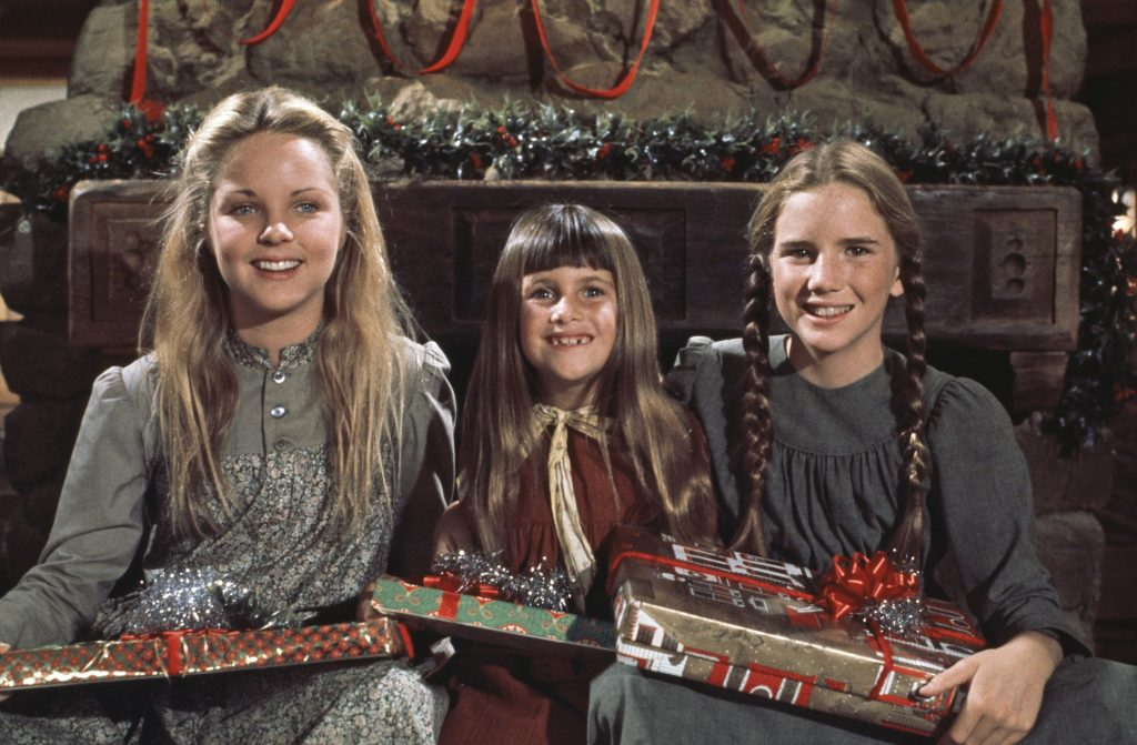 Melissa Sue Anderson as Mary Ingalls, Lindsay/Sidney Greenbush as Carrie Ingalls, and Melissa Gilbert as Laura Elizabeth Ingalls holding presents