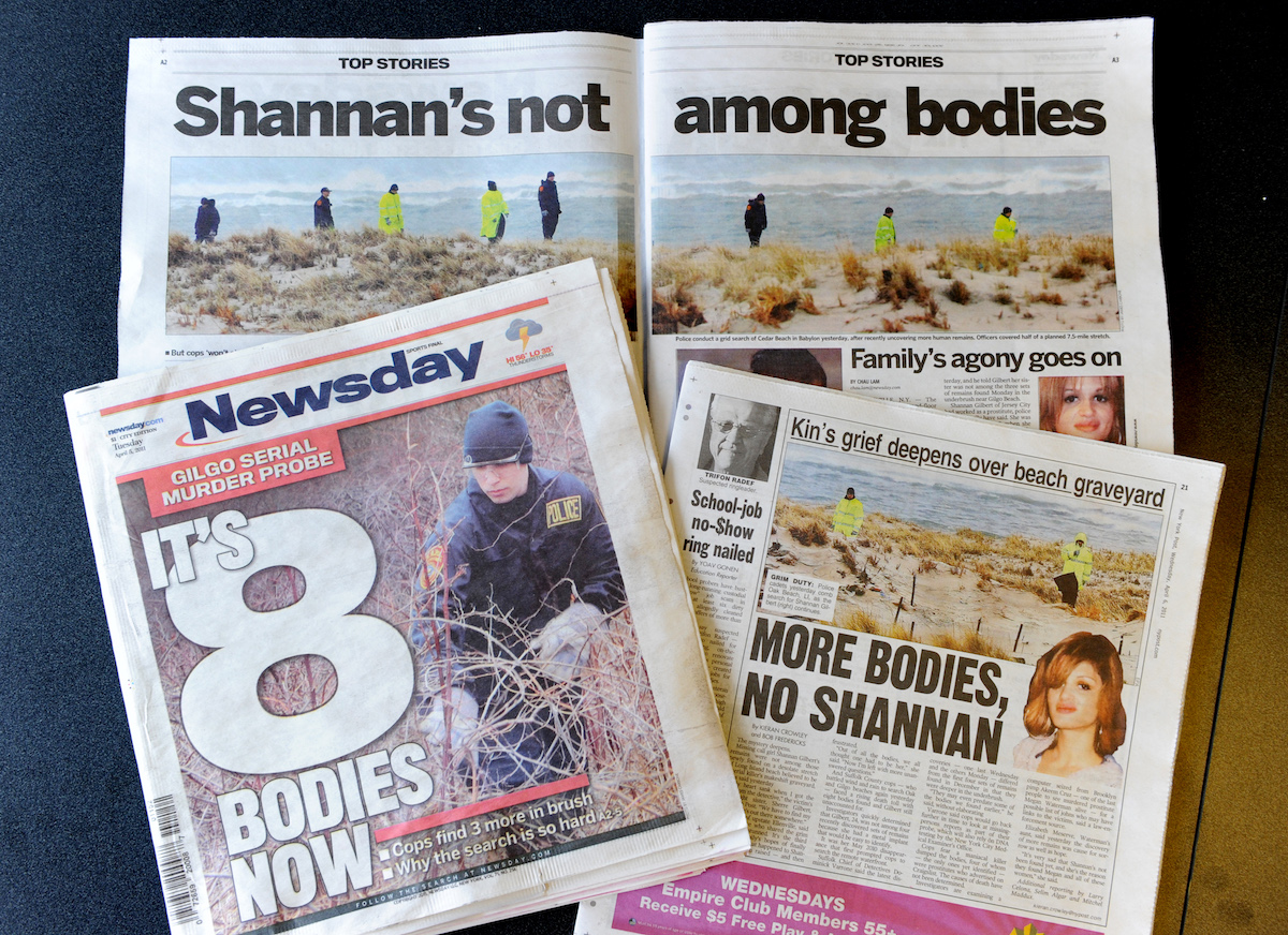 Newspapers with headline about the Long Island serial killer case