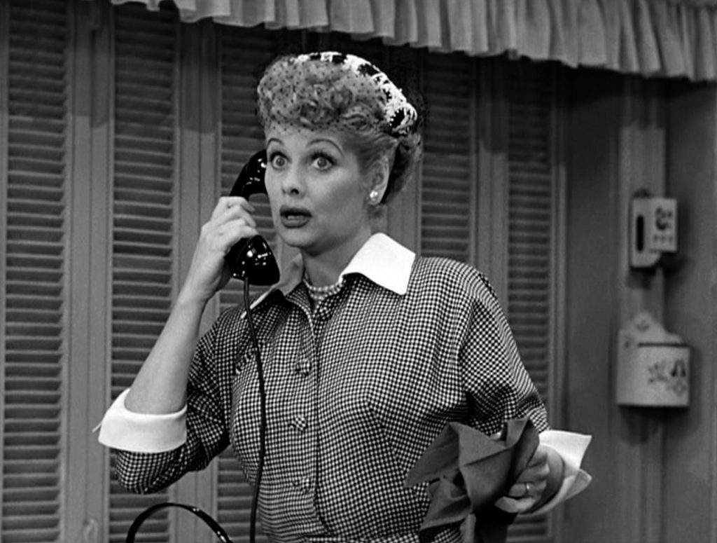 Lucille Ball holding a phone