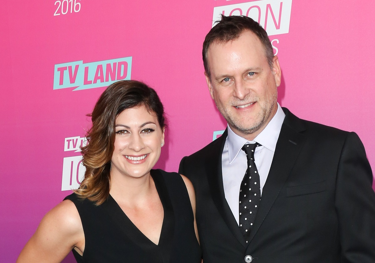 Dave Coulier and his wife, Melissa Bring, posing