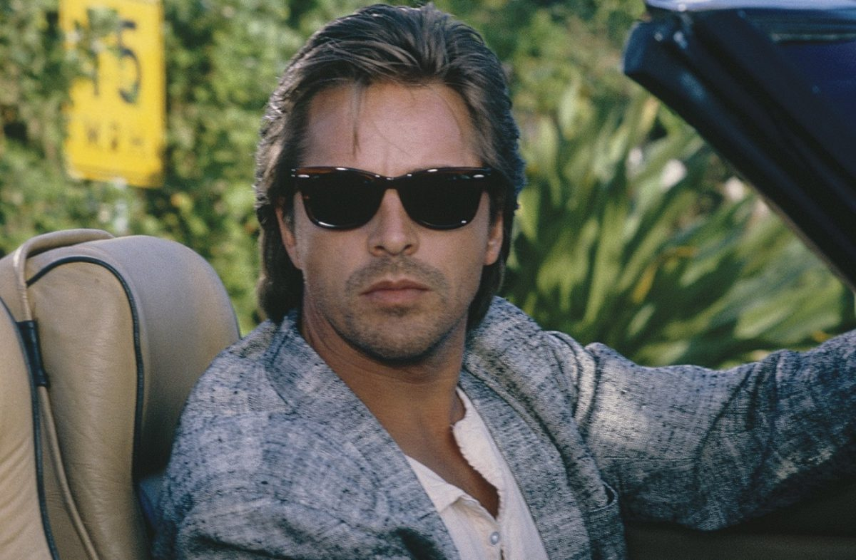 Don Johnson sitting in driver's seat at Crockett on 'Miami Vice'