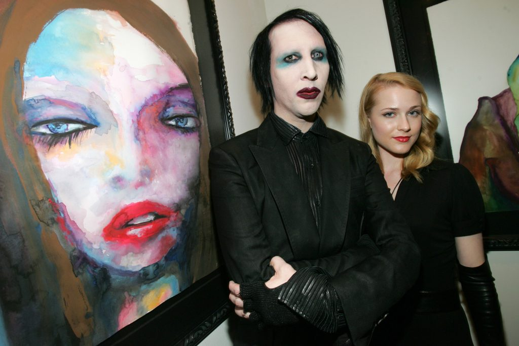 Marilyn Manson and Evan Rachel Wood next to a painting