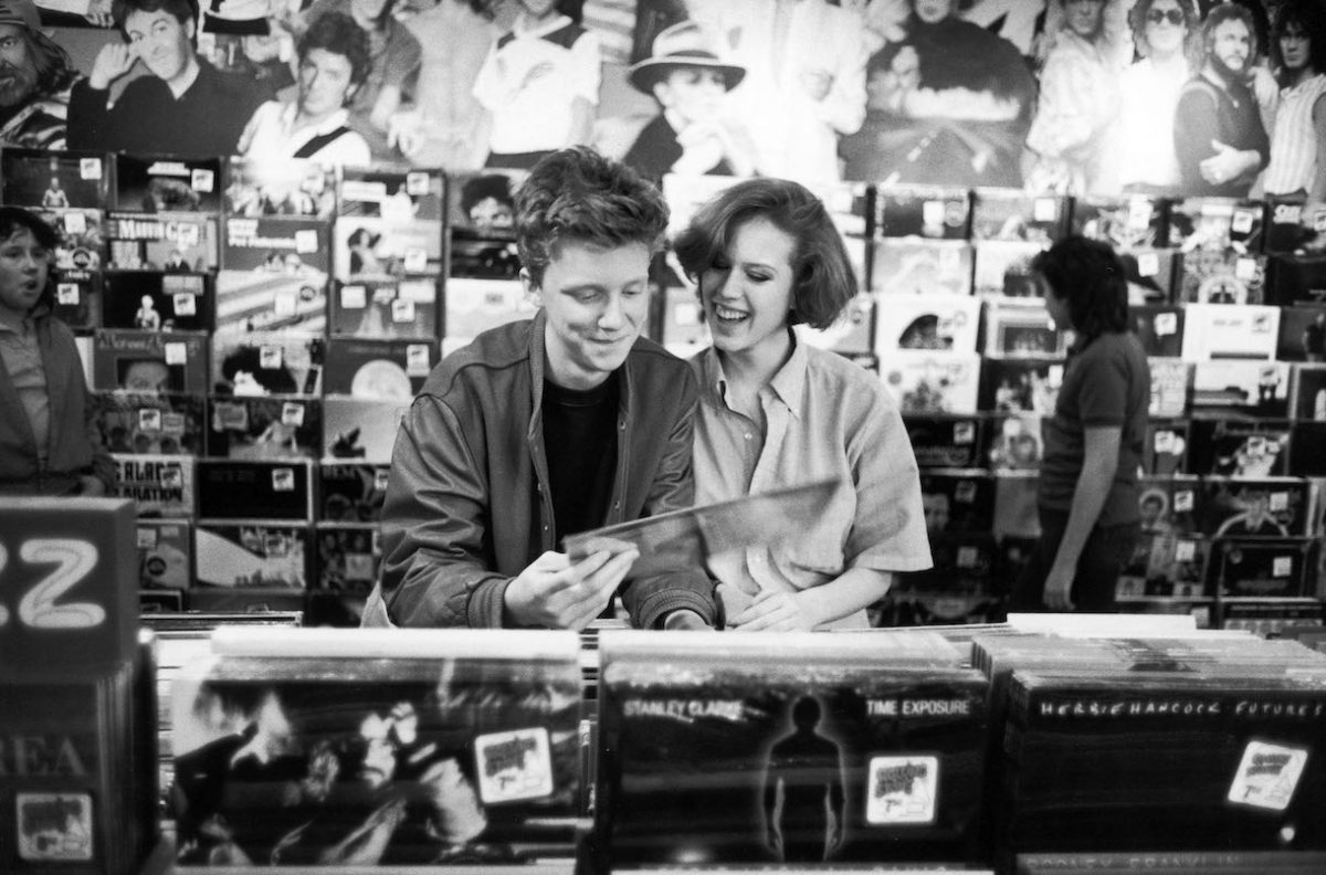 Actors Anthony Michael Hall and Molly Ringwald browsing in record shop during break in location shooting of 'The Breakfast Club'