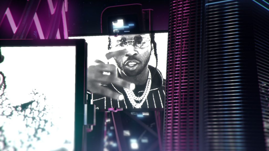 Pop Smoke appears on a screen at the BET Hip Hop Awards during a tribute while Quavo is performin