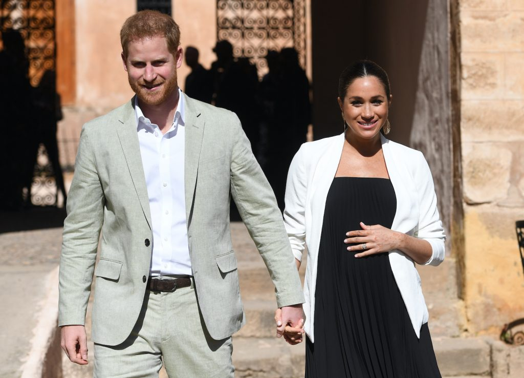 Prince Harry and Meghan Markle walk through the walled public Andalusian Gardens during a visit on February 25, 2019 in Rabat, Morocco