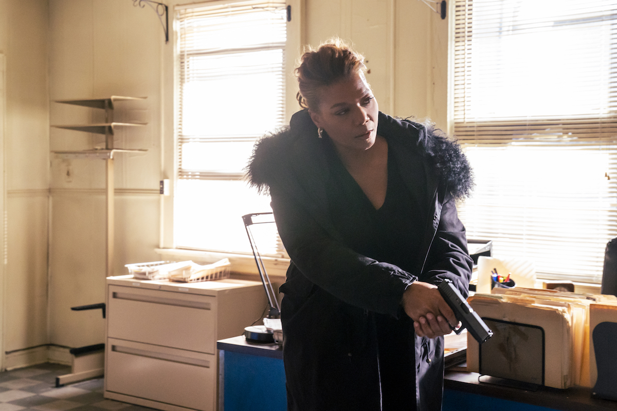 Queen Latifah as Robyn McCall holding a gun in an episode of The Equalizer