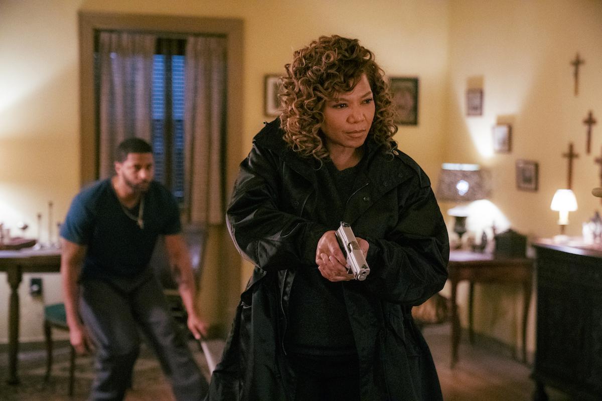 Queen Latifah as Robyn McCall holding a gun