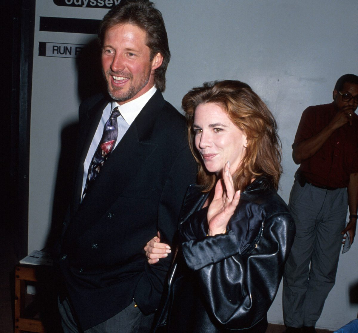 Bruce Boxleitner and Melissa Gilbert — Gilbert is holding Boxleitner's arm, smiling and waving.