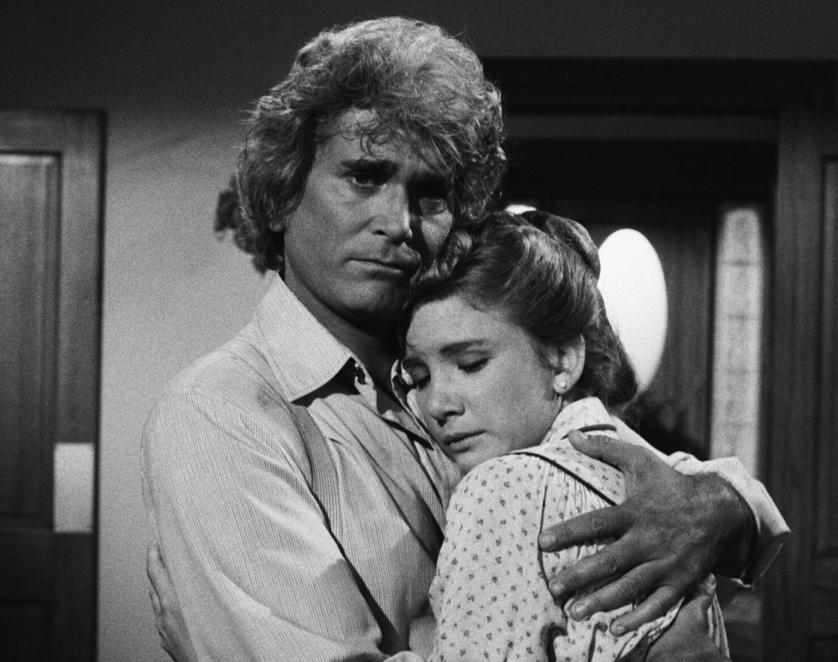 Michael Landon hugging Melissa Gilbert in black and white. A still from 'Little House: A New Beginning'