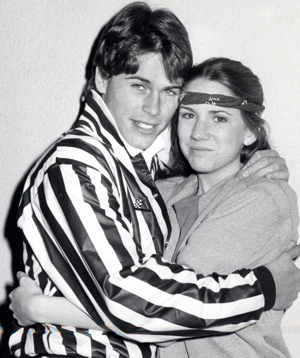 Rob Lowe and Melissa Gilbert embrace in black and white