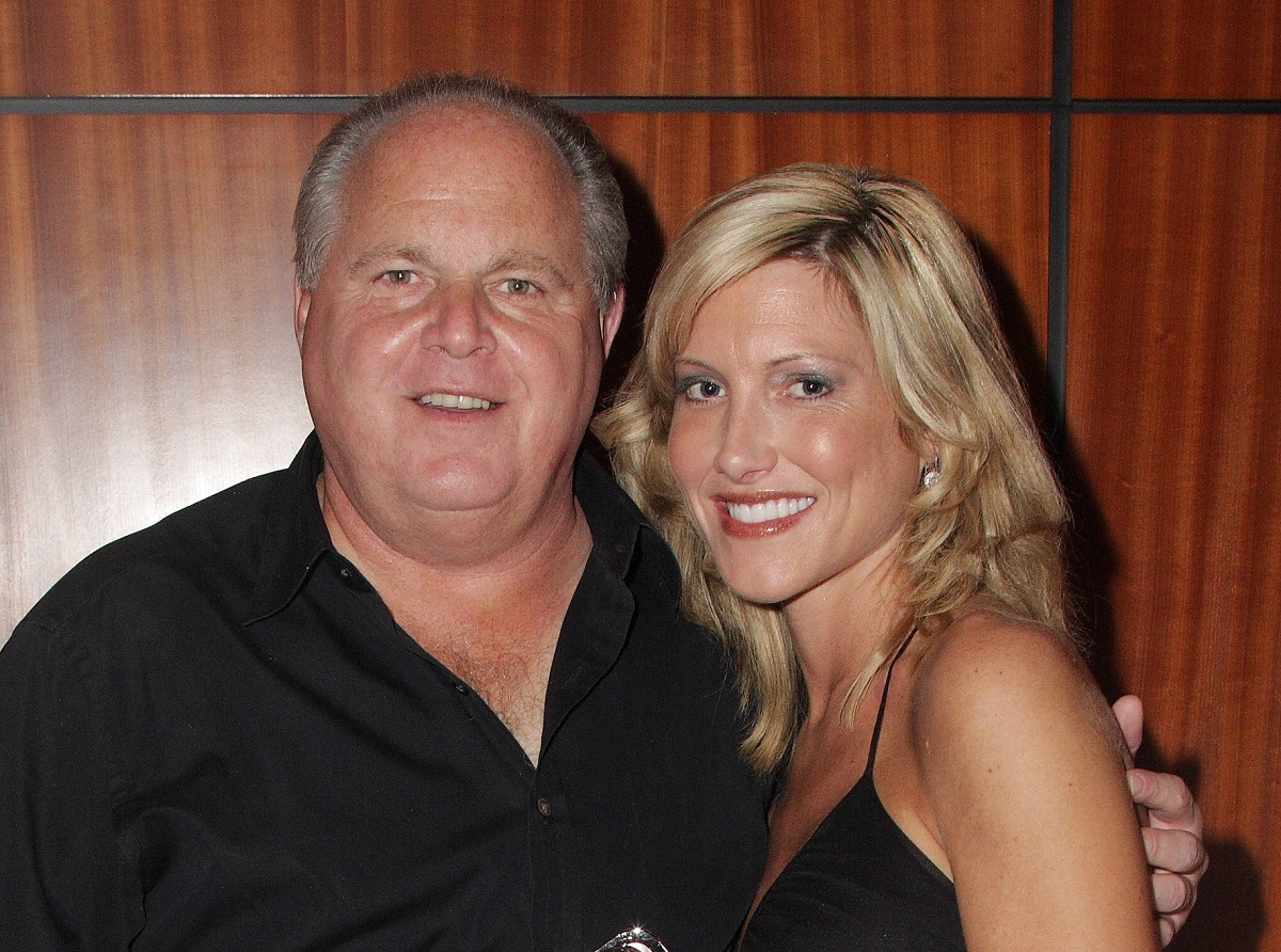 Rush Limbaugh and Kathryn Adams Limbaugh pose in all black