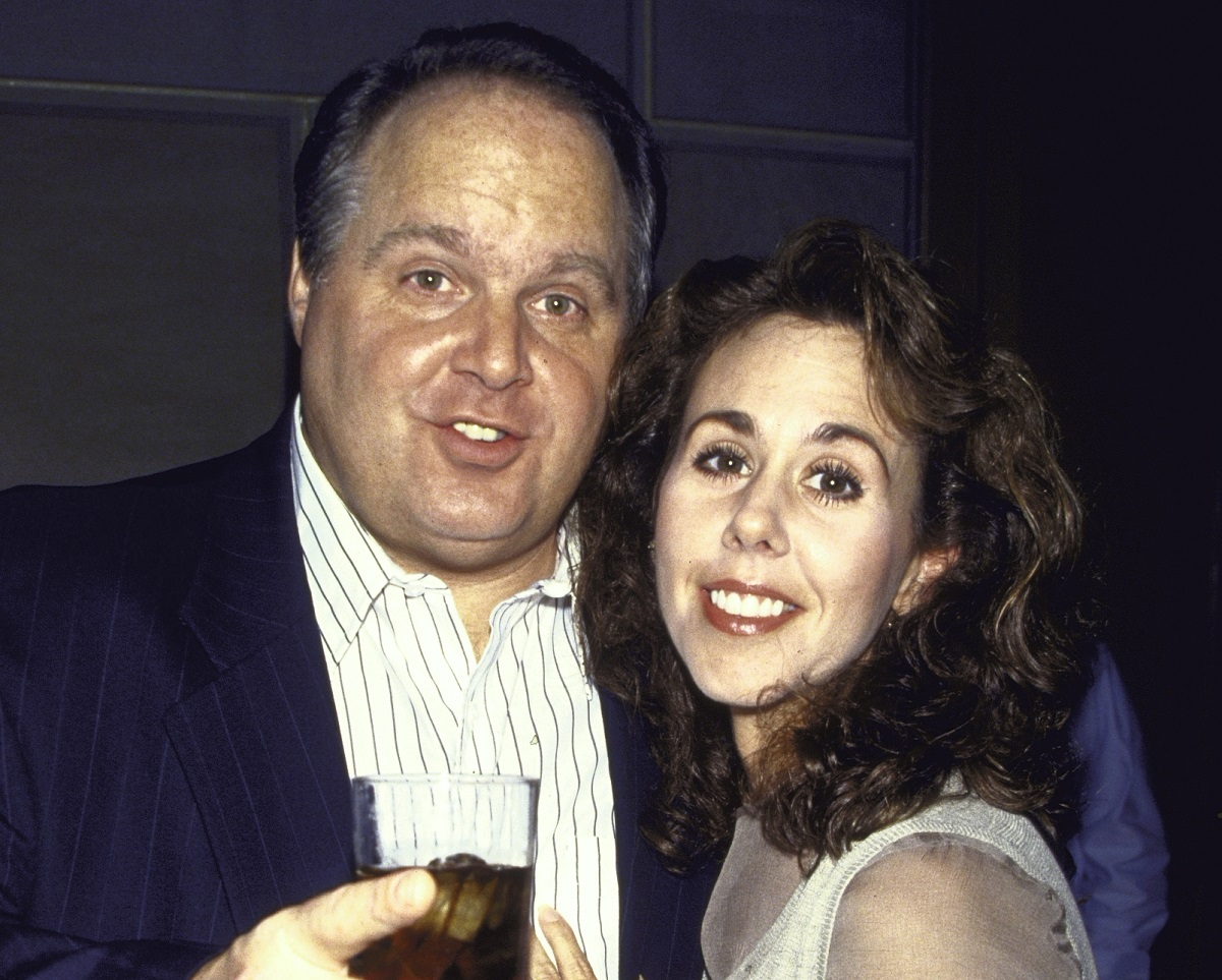 Rush Limbaugh holds a drink next to third wife Marta