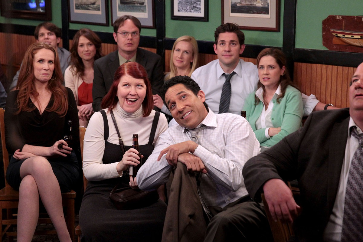 A group of 'The Office' actors gathered together in a scene from the show