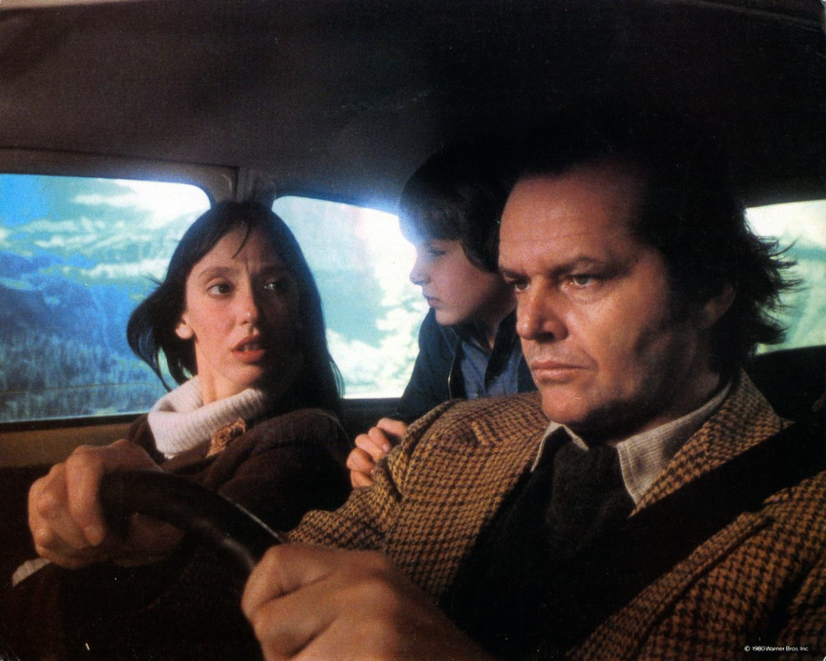 Shelley Duvall, Danny Lloyd, and Jack Nicholson in car on their way to resort in lobby card for the film 'The Shining', 1980