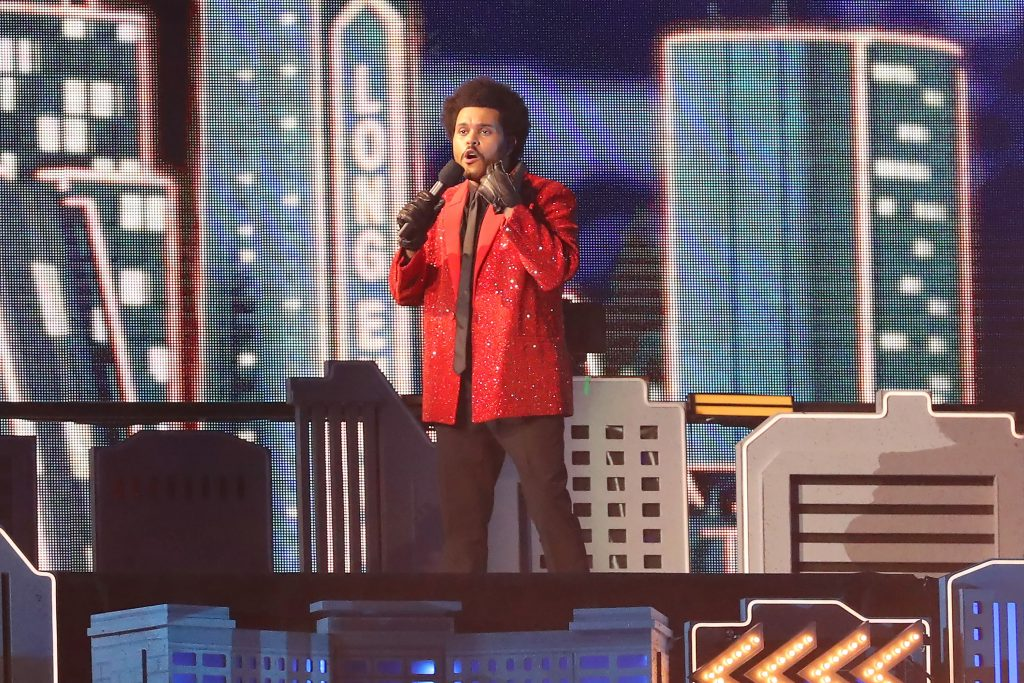 The Weeknd performing at the Super Bowl wearing a red suit