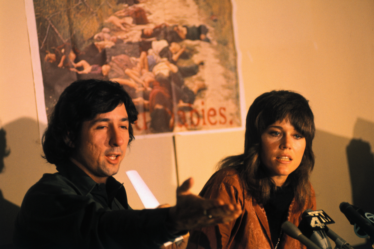 Tom Hayden and Jane Fonda at a news conference in 1973