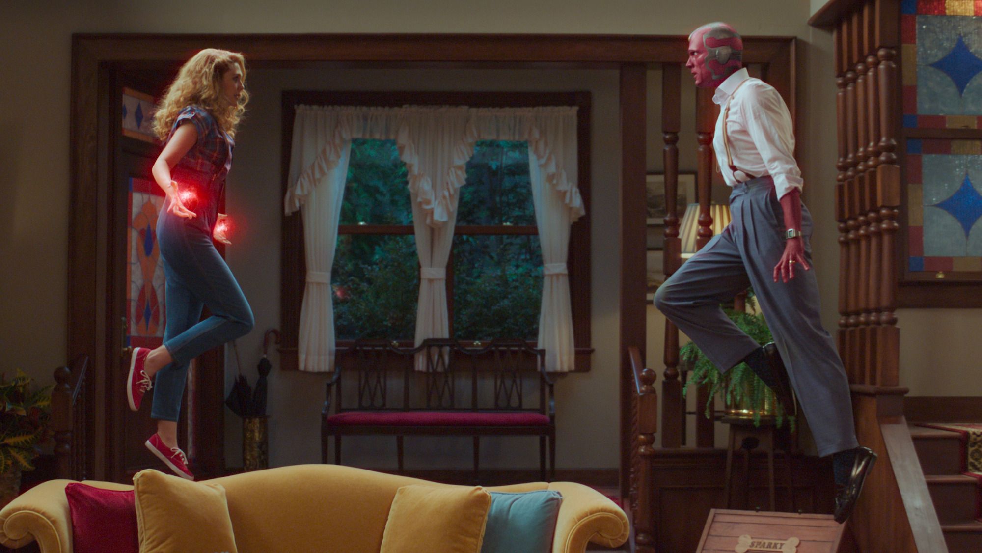 Elizabeth Olsen as Wanda Maximoff and Paul Bettany as Vision