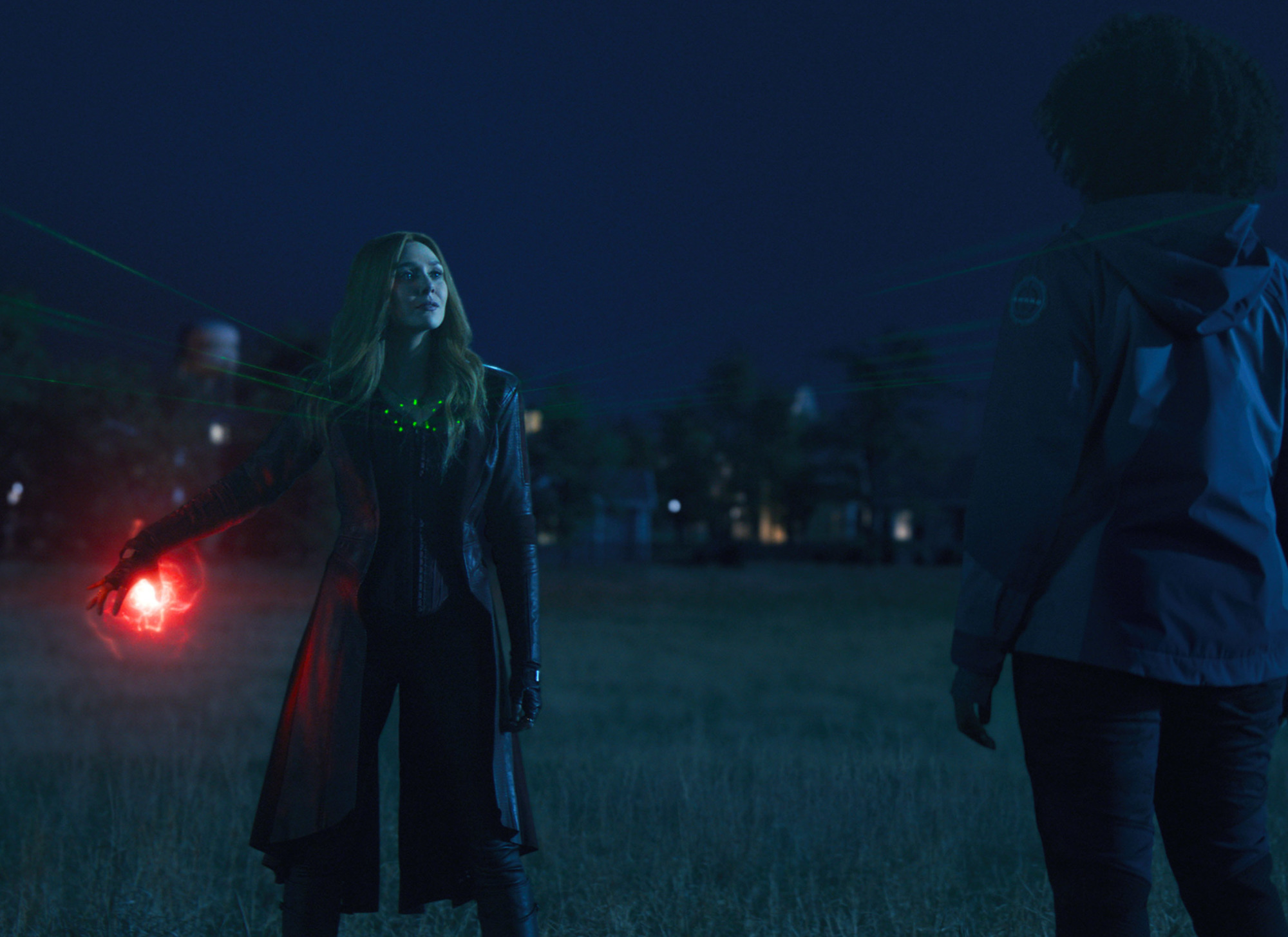 Olsen as Wanda in 'WandaVision' talking to Monica Rambeau (Teyonah Parris) and S.W.O.R.D.