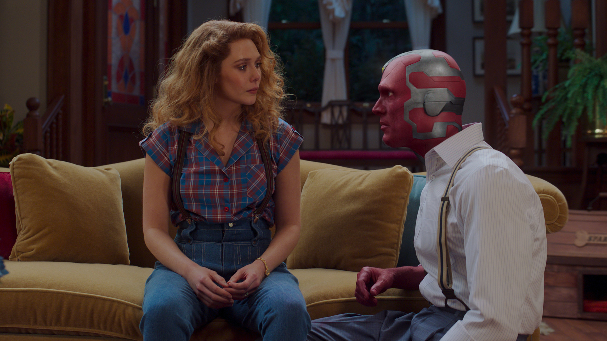 Elizabeth Olsen as Wanda Maximoff and Paul Bettany as Vision in their 80s attire on 'WandaVision'