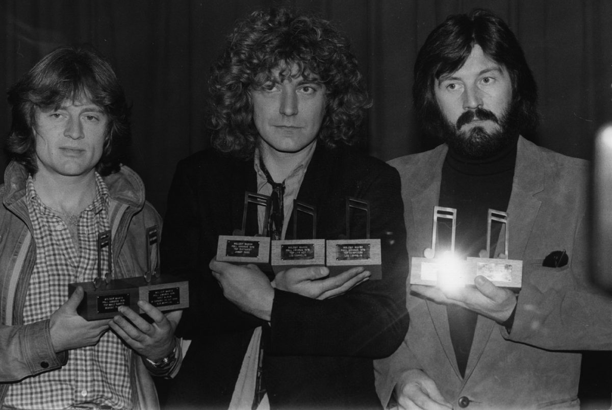Members of Led Zeppelin pose with awards