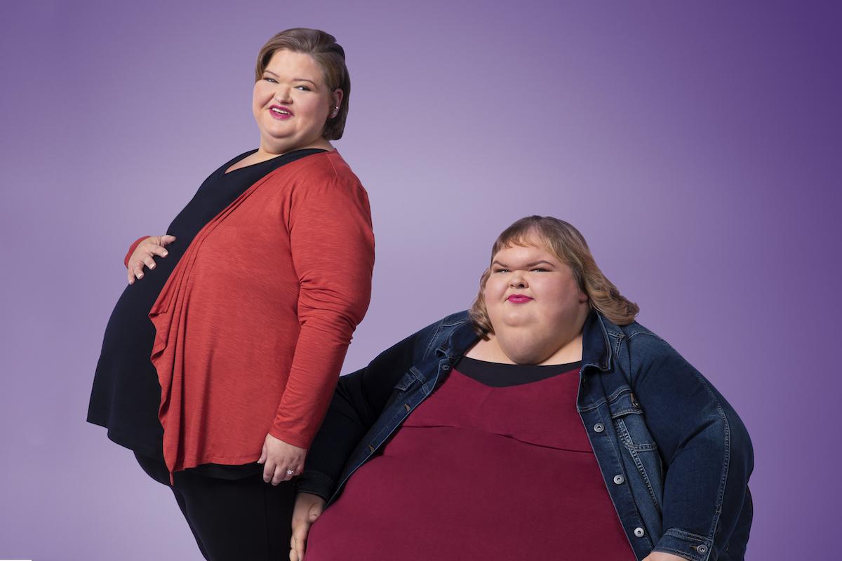 Portrait of Amy Slaton and Tammy Slaton, the Slaton sisters from '1000-Lb Sisters' on a purple background
