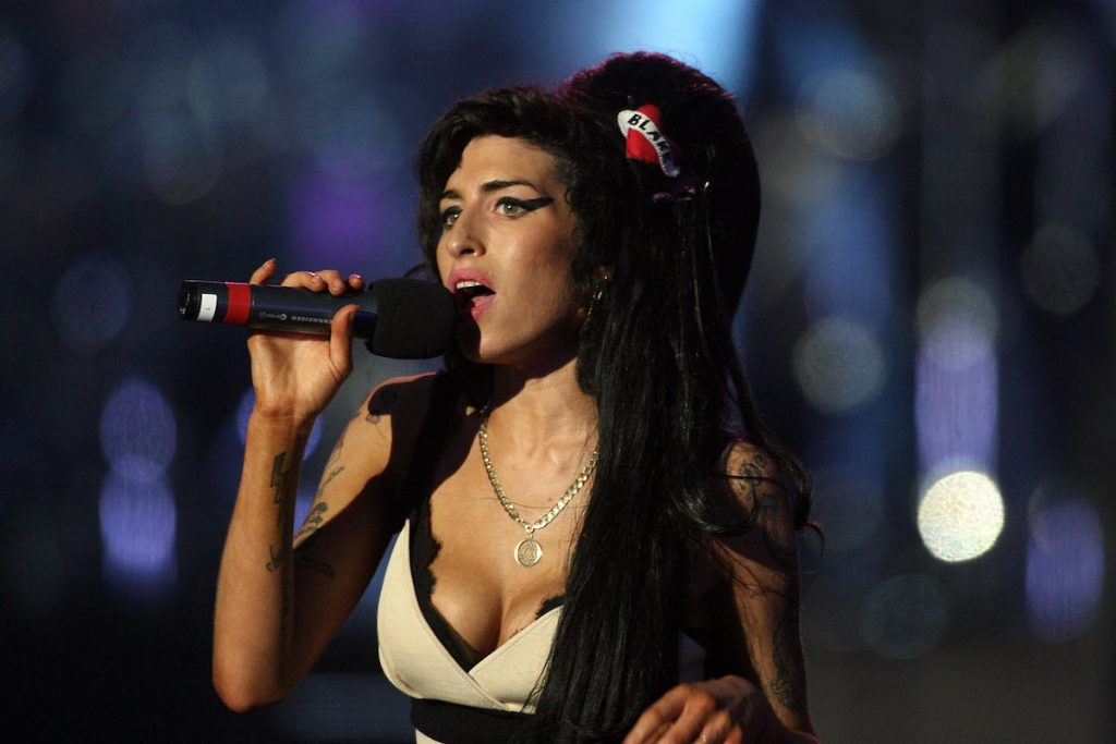 Singer Amy Winehouse performs during a 46664 concert celebrating Nelson Mandela's life at Hyde Park on June 27, 2008, in London, England.