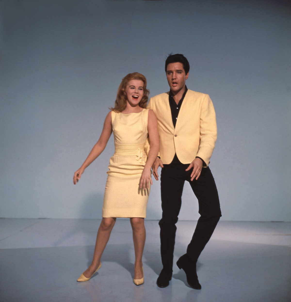 Ann-Margret and Elvis Presley smiling and dancing in a color promotional still from 'Viva Las Vegas'