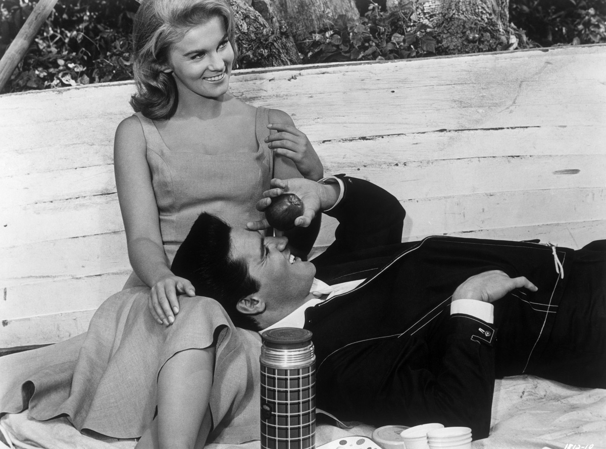 Elvis laughing as he lays his head on Ann-Margret's lap in a scene from 'Viva Las Vegas' (1964)