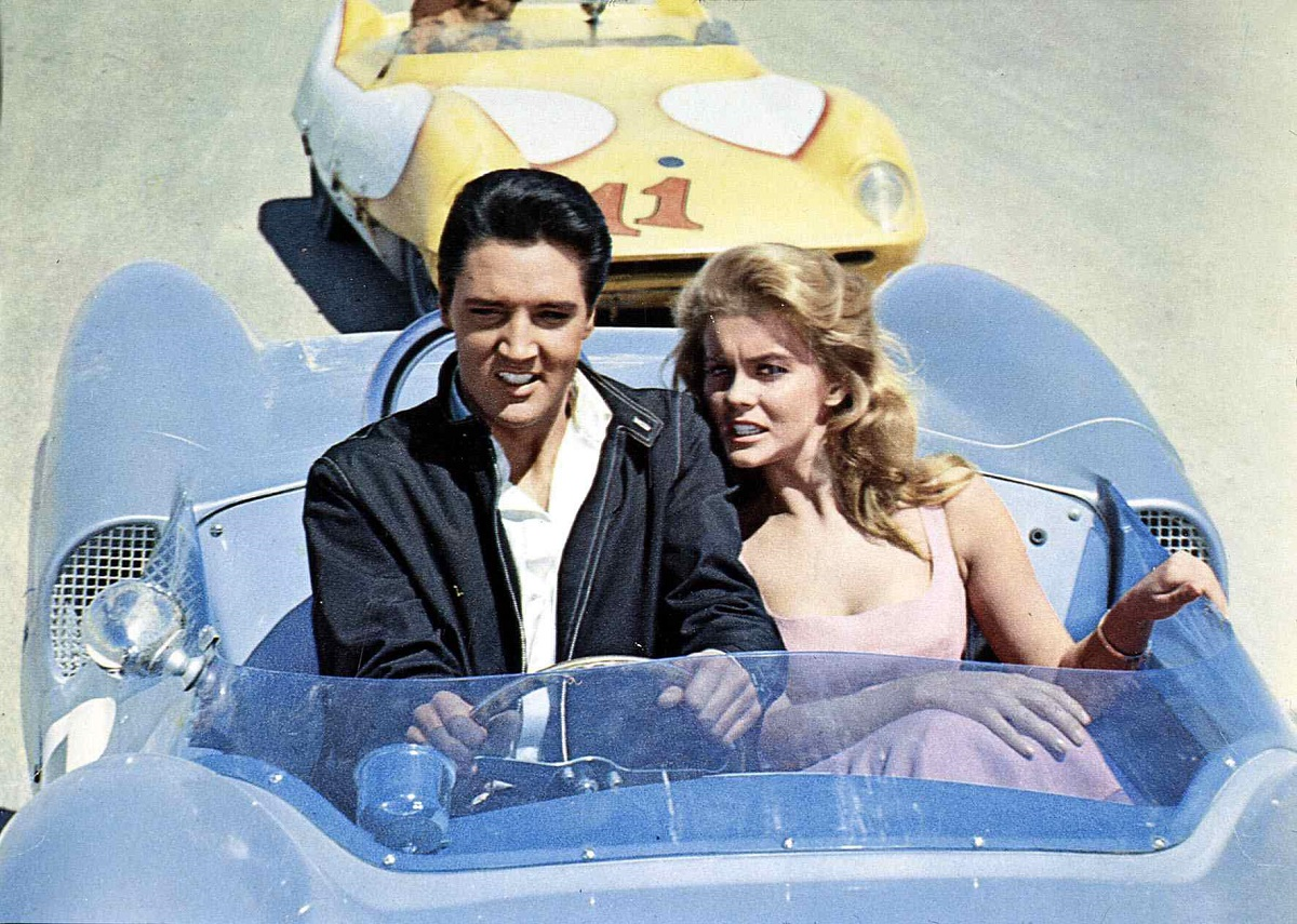Elvis Presley and Ann-Margret driving in a car in a scene from 'Viva Las Vegas'