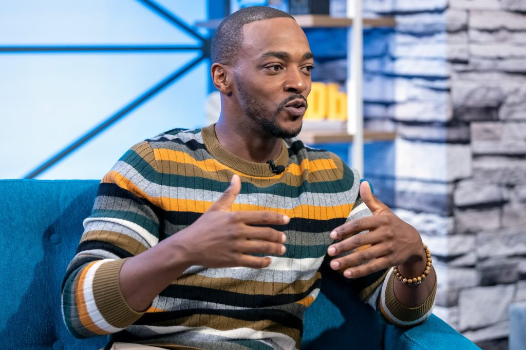 A candid photo of actor Anthony Mackie talking on 'The IMDb Show' in April 2019
