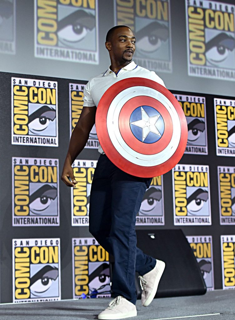 Anthony Mackie holding the Captain America shield