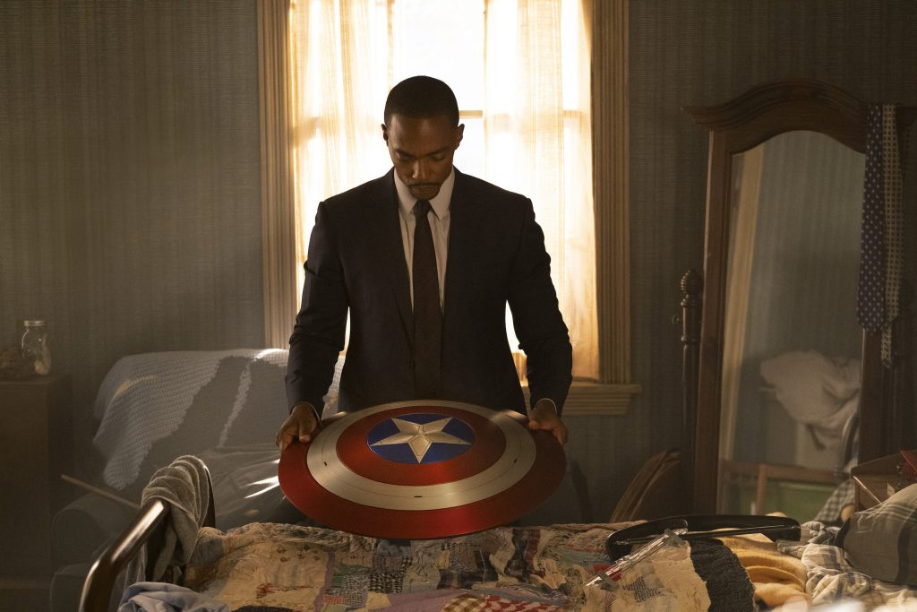 Anthony Mackie holds Captain America's shield