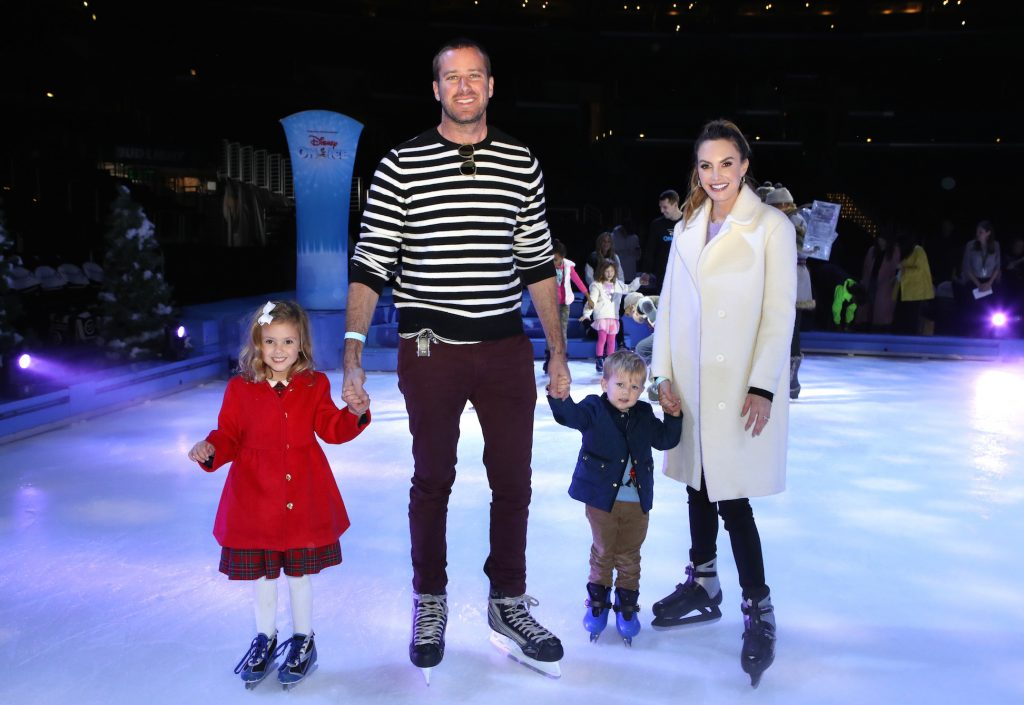 Armie Hammer and Elizabeth Chambers with children Harper and Ford ice skating. Armie Hammer's age is 33, Elizabeth Chambers is 37, Harper is 5, and Ford is almost 3