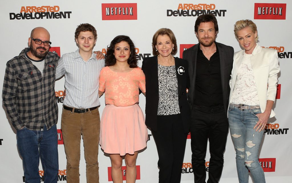 The cast of 'Arrested Development,' including Jessica Walter, standing with her co-stars at a Netflix press conference