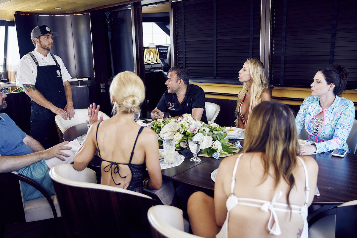 Adam Glick speaks to guests on Below Deck Sailing Yacht