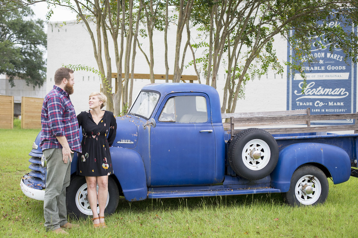 Ben and Erin Napier pose in their hometown of Laurel Mississippi