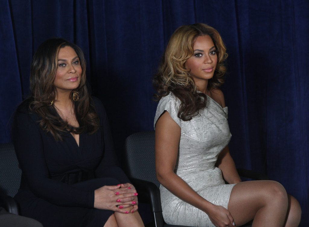 Beyoncé and Tina Knowles sitting next to each other