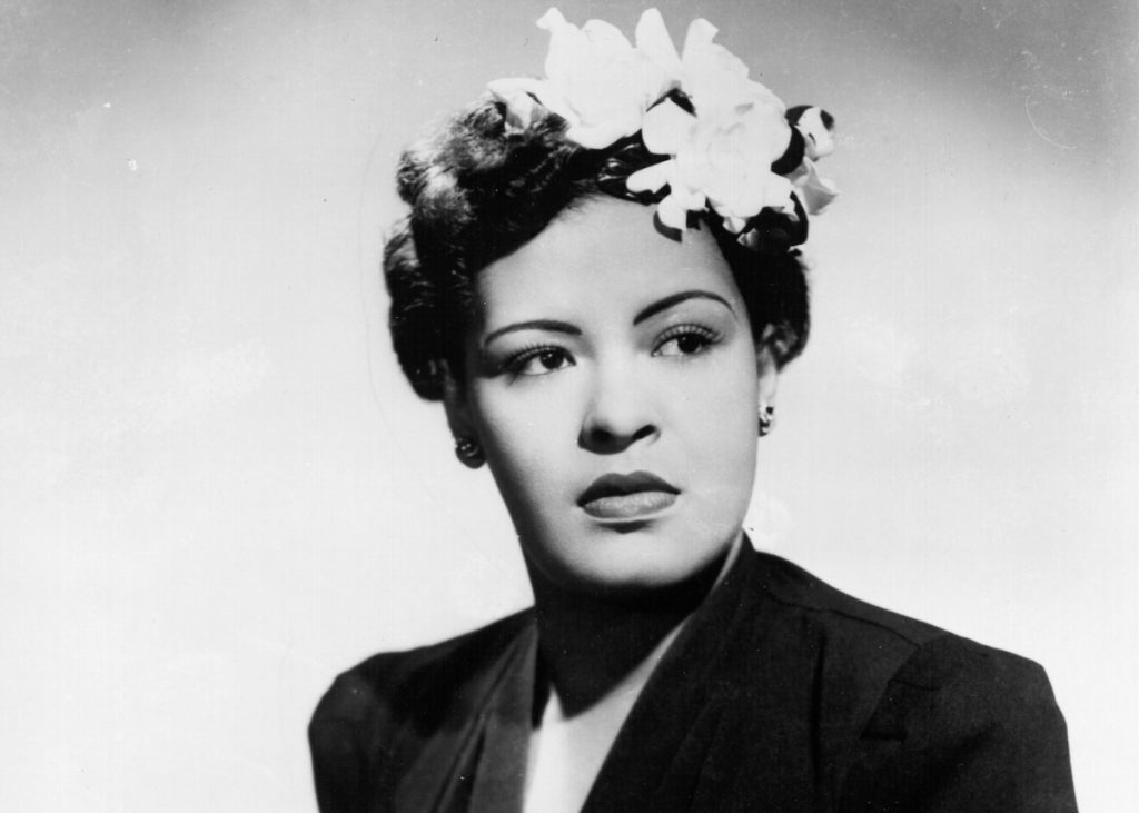 Jazz singer Billie Holiday poses for a portrait circa 1939 with a flower in her hair | Michael Ochs Archives/Getty Images
