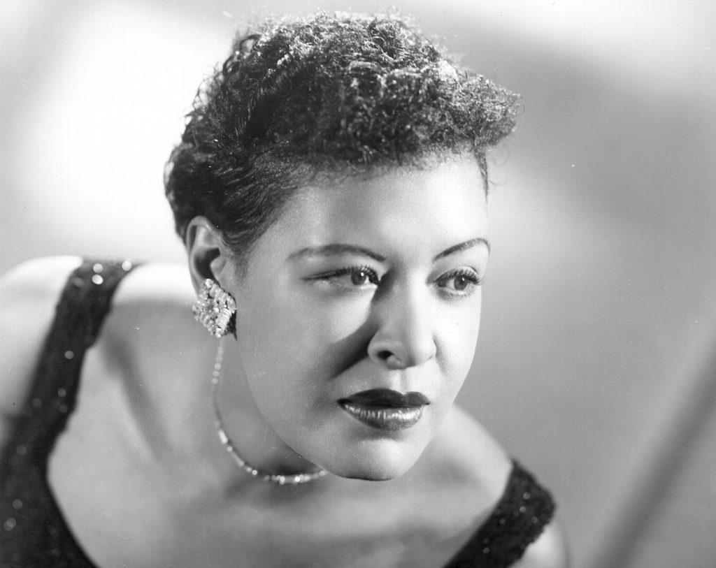 Black-and-white photo of Billie Holiday poses for a portrait in a sparkling black dress   Michael Ochs Archives/Getty Images