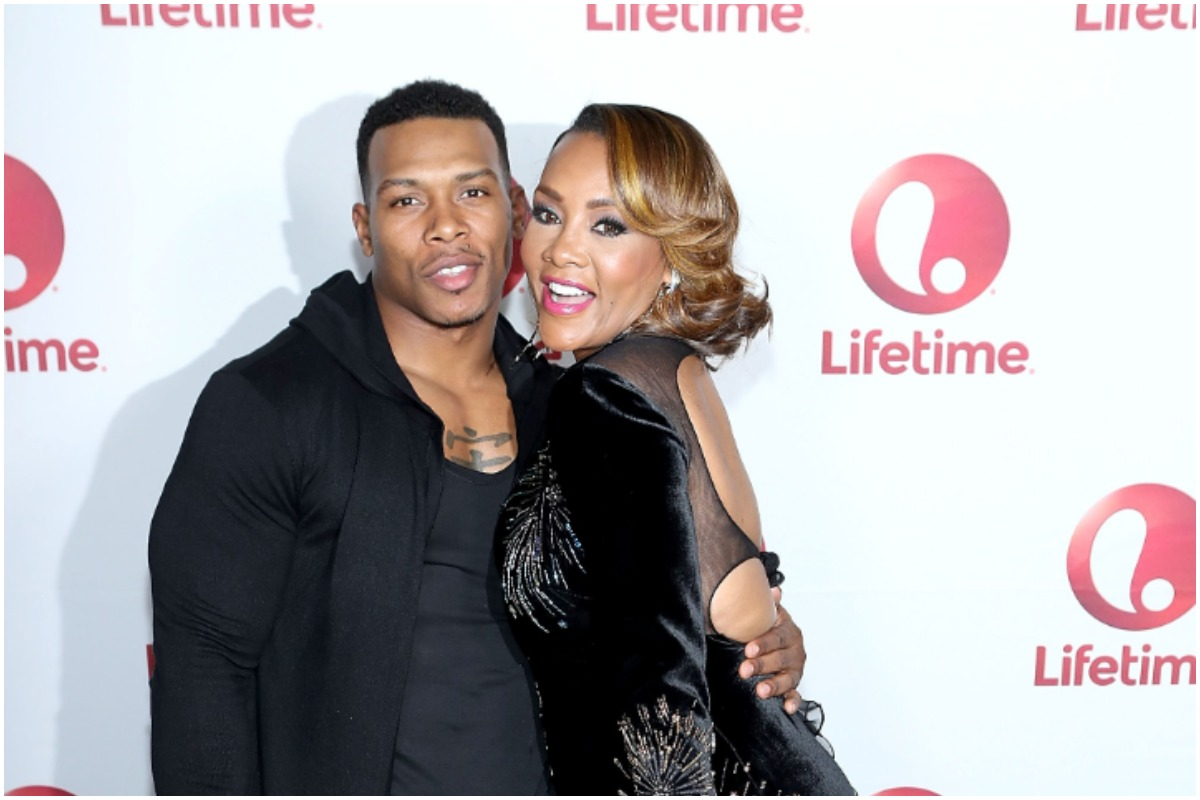 Bolo the Entertainer from The Real Housewives of Atlanta and Vivica A. Fox smiling at a Lifetime event.