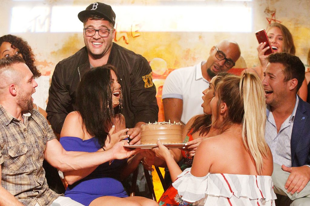 CT Tamburello from 'The Real World' and other members of MTV's 'The Challenge' sitting and laughing together