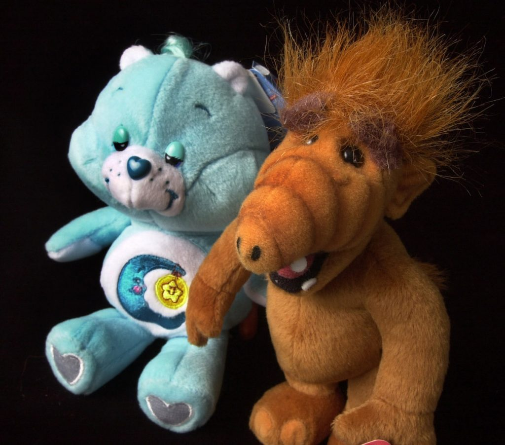 Plush toys reminiscent of the 1980s TV shows featuring the Care Bears and ALF