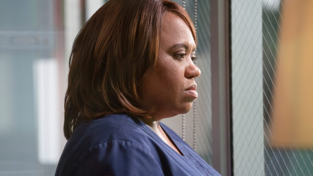 """Chandra Wilson as Miranda Bailey looking out of a window in 'Grey's Anatomy' Season 17 Episode 8, """"It's All Too Much"""""""
