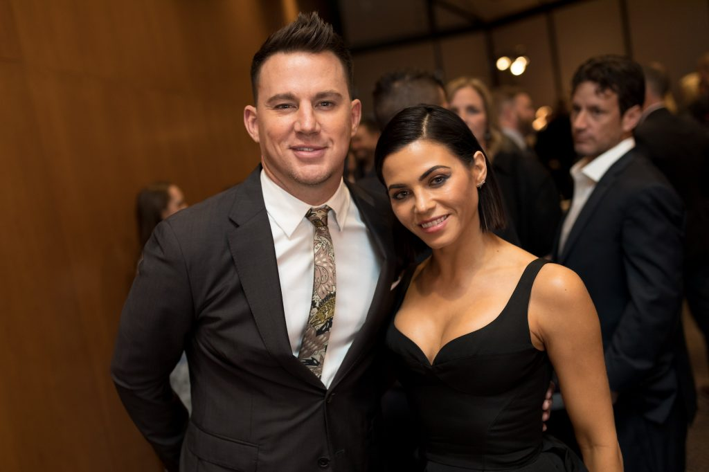Channing Tatum and Jenna Dewan smiling in front of a crowd
