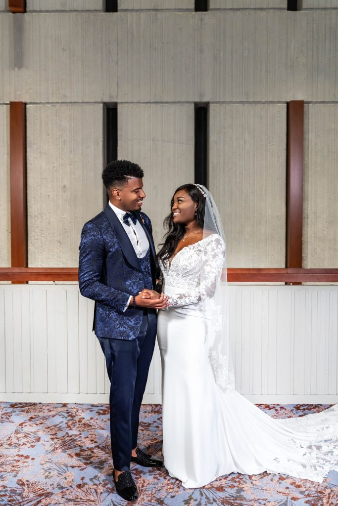 Chris Williams II and Paige Banks pose in their wedding dress and suit on 'Married at First Sight'