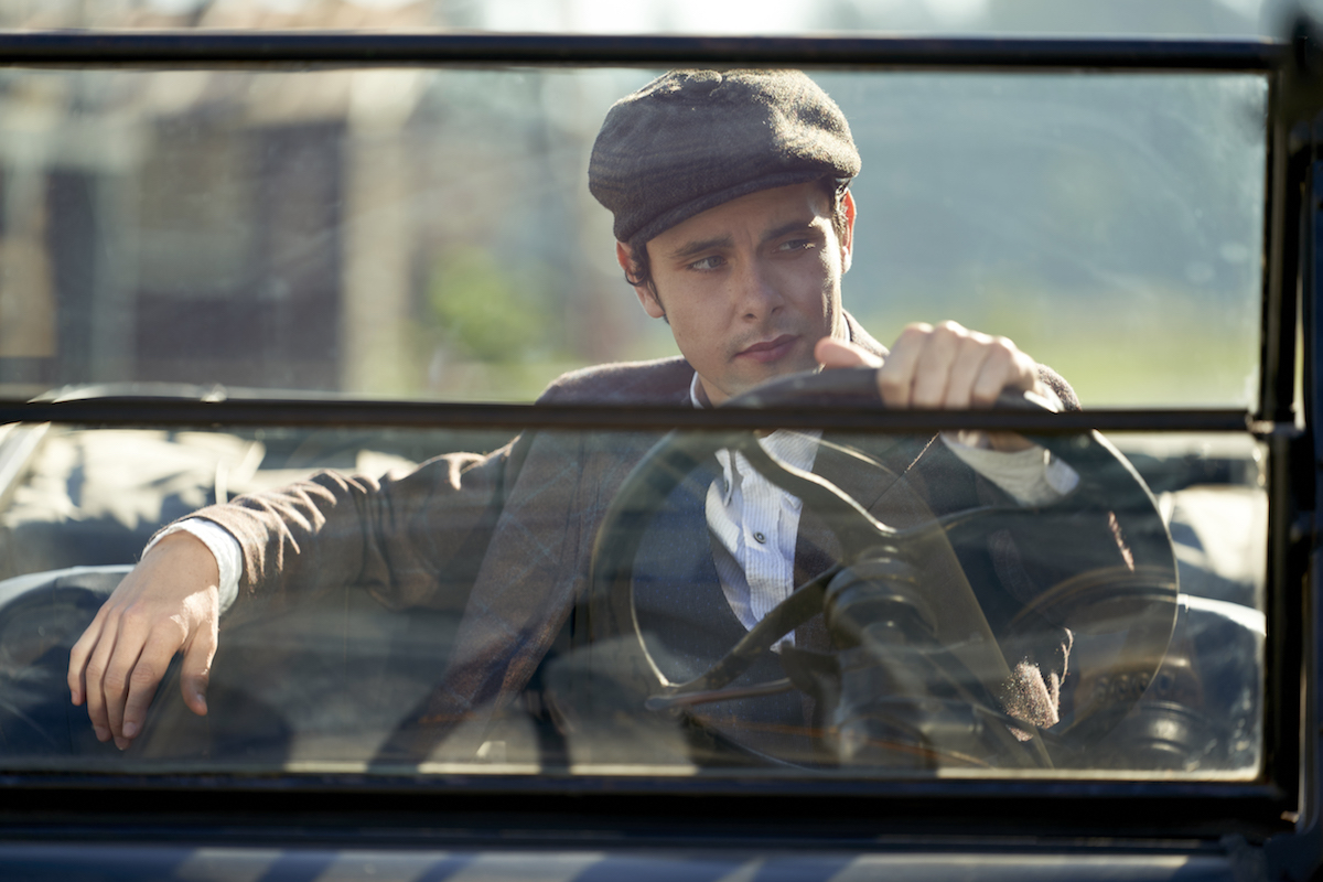 Christopher behind the wheel of a car in When Calls the Heart