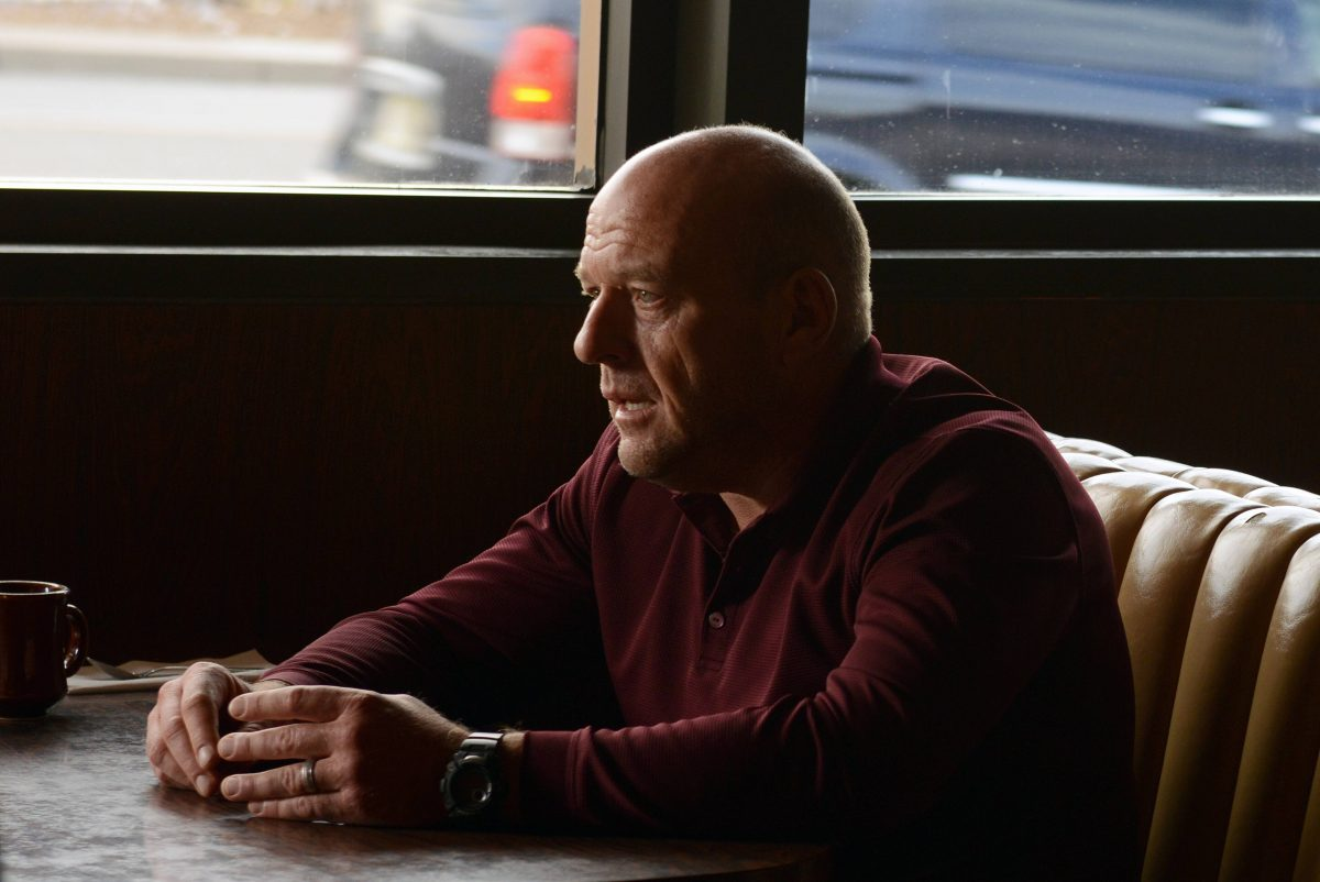 Dean Norris sits in a booth