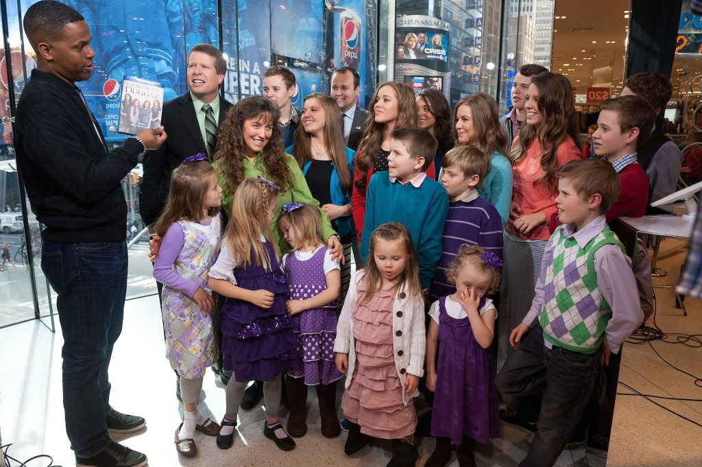 Jim Bob and Michelle Duggar with the rest of the Duggar family talking the latest Duggar news to AJ Calloway during their visit to 'Extra'